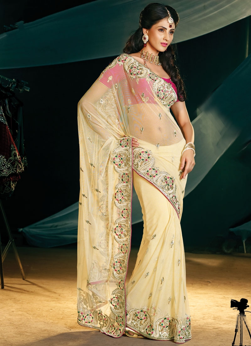 Irresistible Cream And Magenta Net Saree
