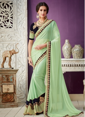 Lace Work Faux Georgette Mint Green and Navy Blue Trendy Classic Saree