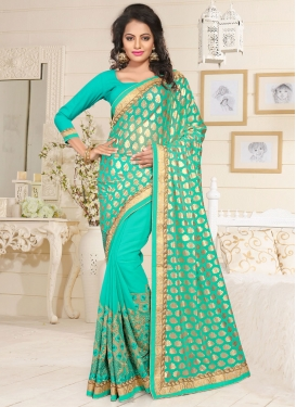 Lavish Embroidered Work Faux Georgette Turquoise Trendy Designer Saree