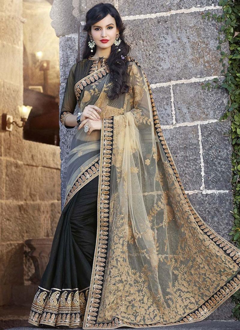 Luxurious Stone Work Black Party Wear Saree