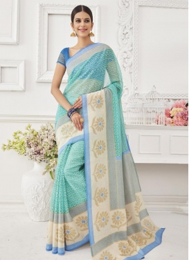 Magnetize Aqua Blue and Cream  Brasso Georgette Classic Saree