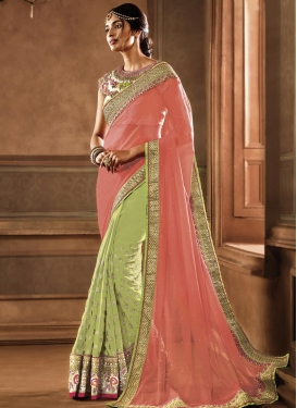 Magnificent Mint Green and Salmon Embroidered Work Half N Half Saree