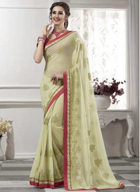 Marvelous Booti Work  Faux Georgette Traditional Saree