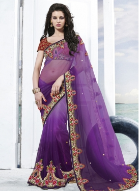 Mesmeric Floral Work Net Wedding Saree