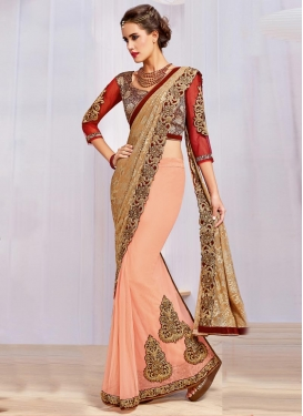 Monumental  Booti Work Beige and Peach Designer Lehenga Style Saree