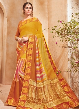 Mustard and Orange Faux Georgette Classic Saree