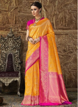 Mustard and Rose Pink Jacquard Silk Trendy Classic Saree For Ceremonial