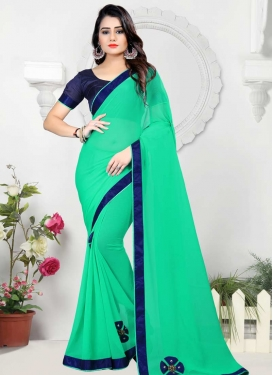 Navy Blue and Sea Green Beads Work Trendy Saree