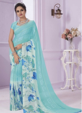 Off White and Turquoise Faux Georgette Traditional Saree
