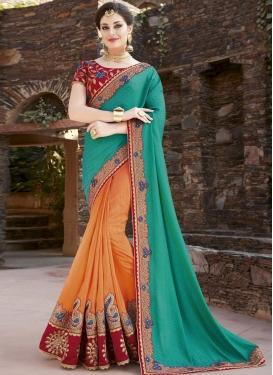 Orange and Sea Green Embroidered Work Half N Half Trendy Saree