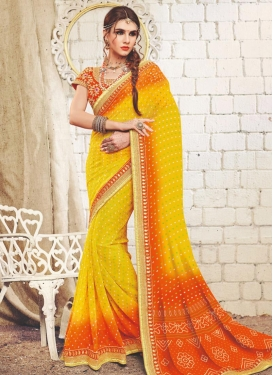 Orange and Yellow Faux Georgette Contemporary Style Saree