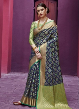 Patola Silk Mint Green and Navy Blue Trendy Saree For Festival