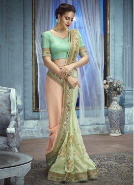 Peach and Turquoise Aari Work Half N Half Saree