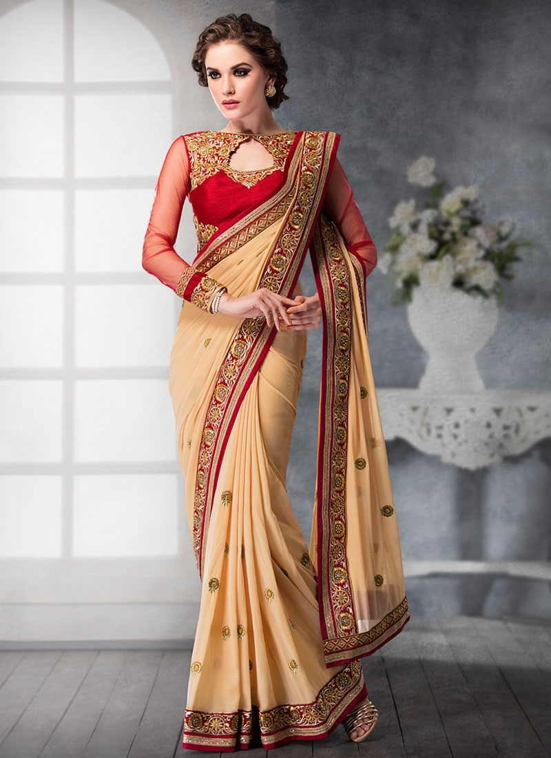 Phenomenal Cream Color Patch Border Work Designer Saree