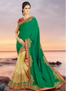 Piquant  Cream and Green Silk Embroidered Work Half N Half Saree