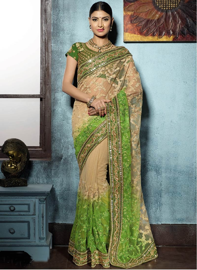 Piquant Embroidery And Mirror Work Net Bridal Saree