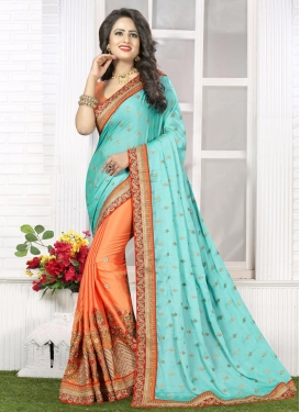 Precious  Coral and Turquoise Embroidered Work Half N Half Saree