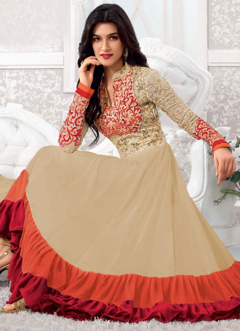 Pretty Beige And Orange Color Jaal Work Anarkali Suit