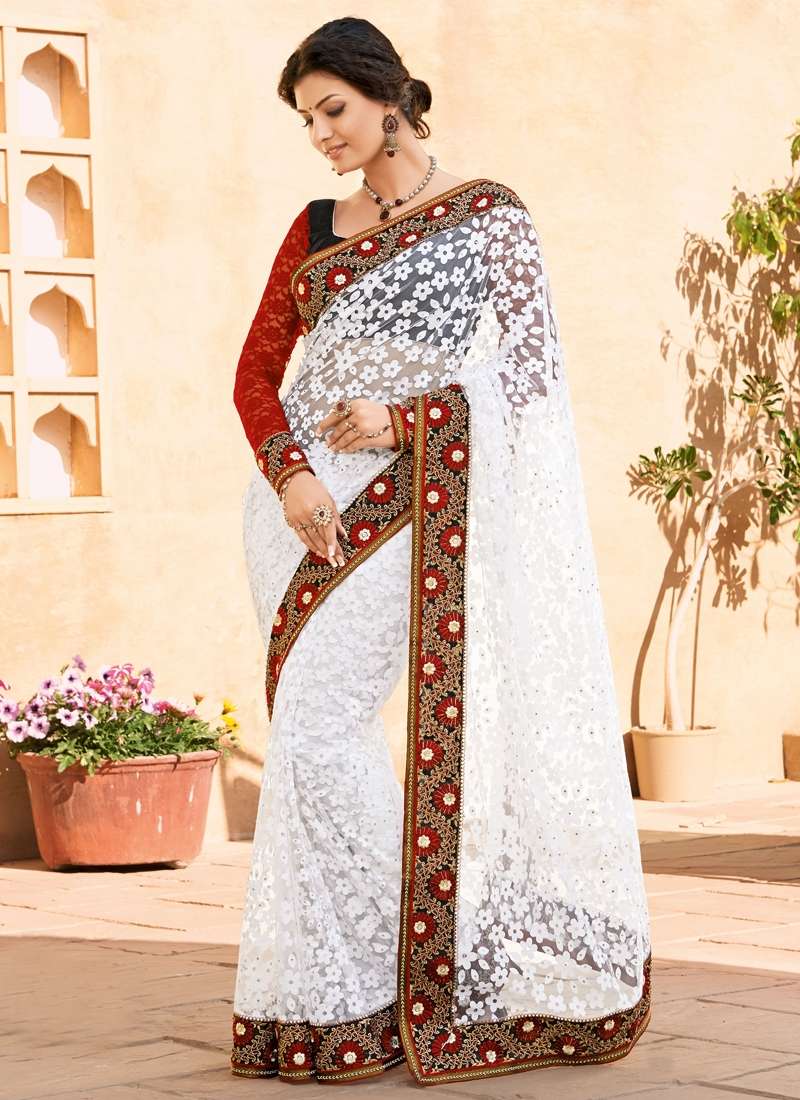 Prominent Multi And Stone Work Party Wear Saree
