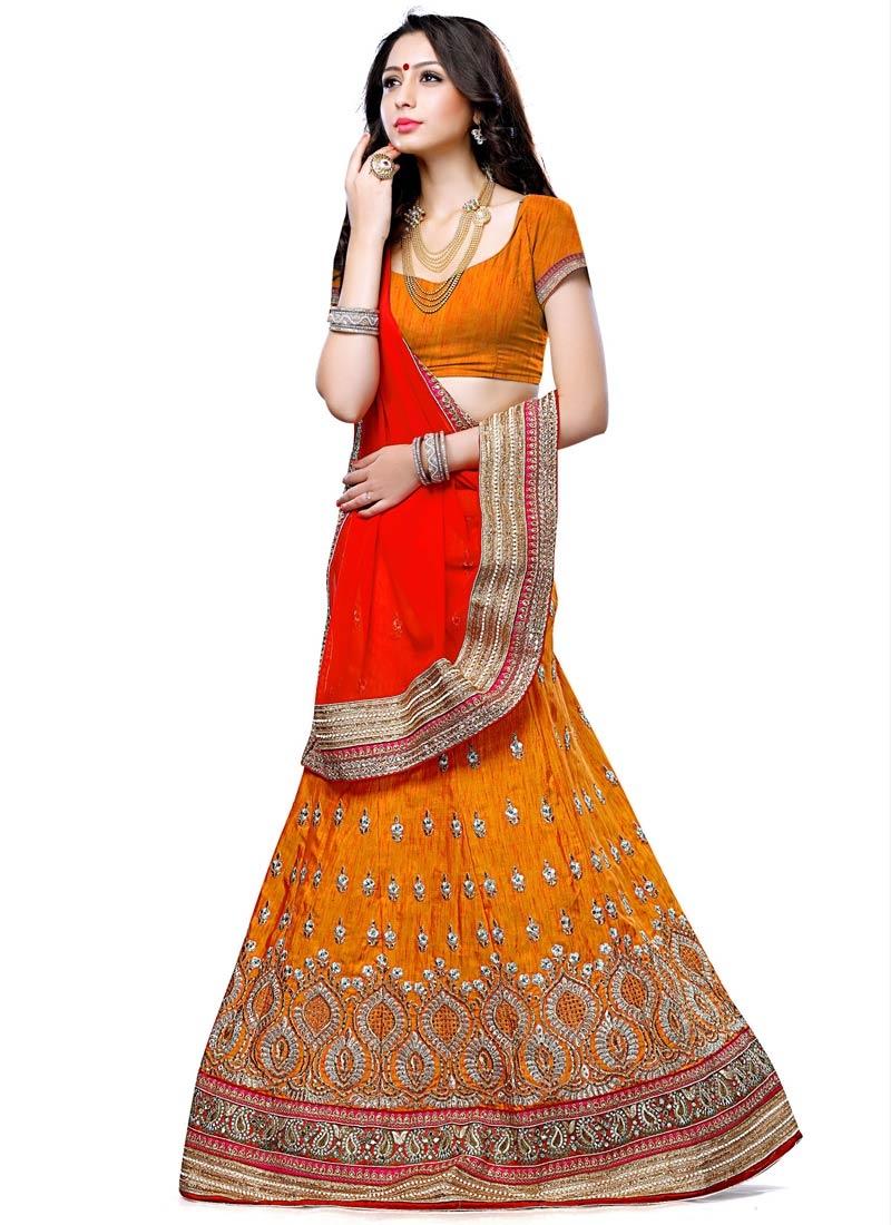 Prominent Orange Color Mirror Work Designer Lehenga Choli