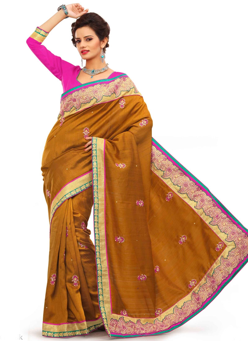 Radiant Stone Work Mustard Color Party Wear Saree