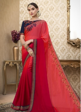 Red and Salmon Embroidered Work Faux Chiffon Trendy Saree