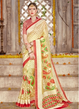 Riveting Cream and Red Brasso Georgette Classic Saree