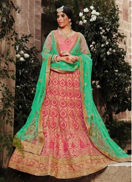 Salmon and Turquoise Net Lehenga Choli