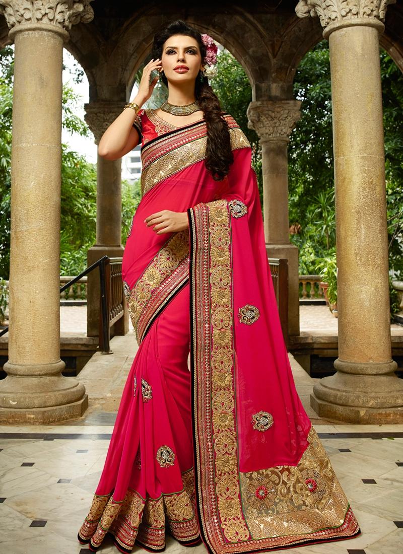 Savory Stone And Lace Work Wedding Saree