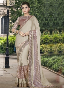 Sightly Silk Georgette Beige and Brown Lace Work Traditional Designer Saree