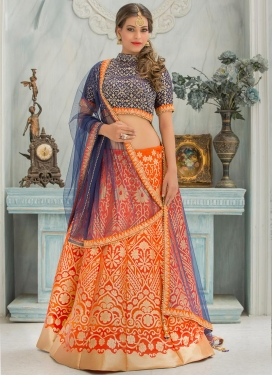Simplistic Jacquard Silk Navy Blue and Orange Beads Work A Line Lehenga Choli