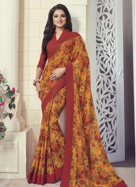 Simplistic Lace Work Crimson and Orange Faux Georgette Traditional Saree For Ceremonial