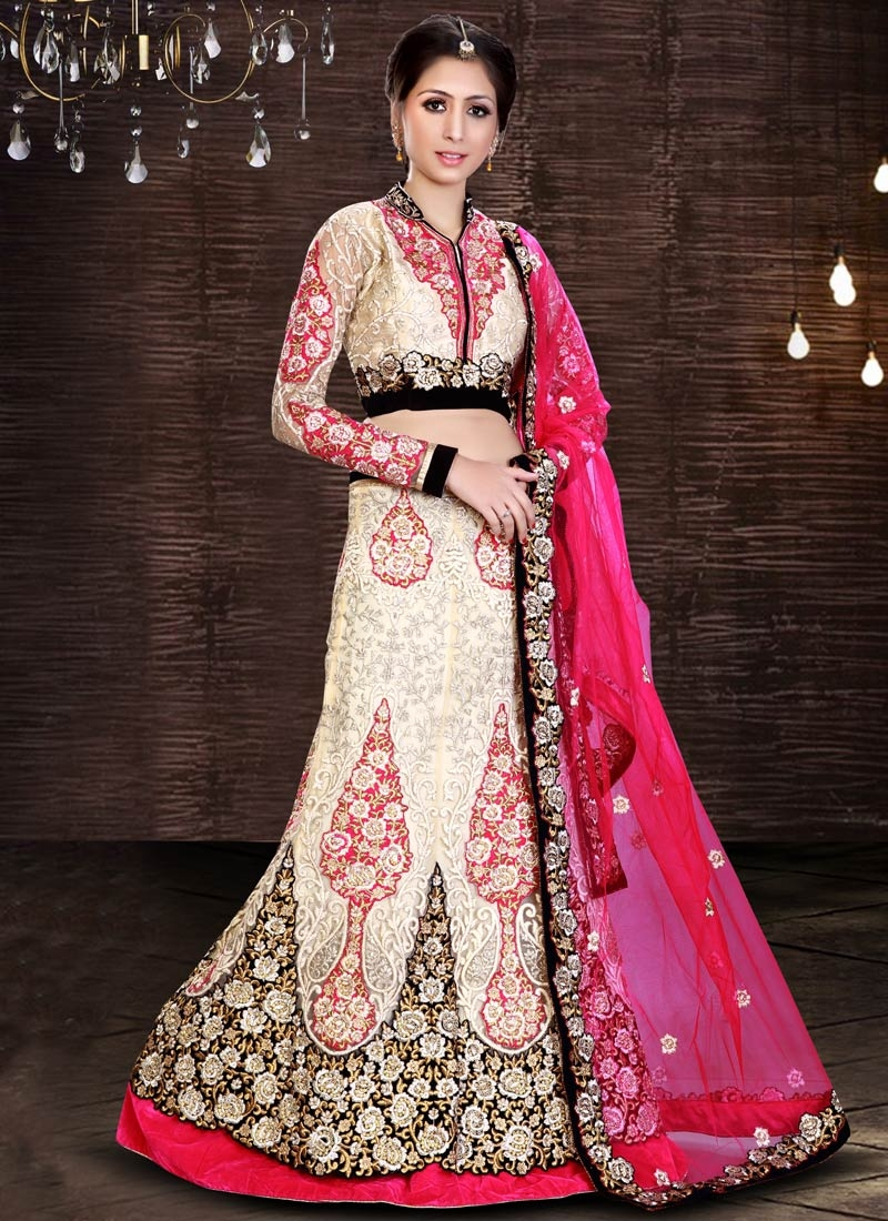 Sonorous Velvet Patch And Stone Work Bridal Lehenga Choli