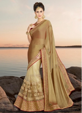 Sophisticated Beige and Brown Cutdana Work Faux Chiffon Traditional Designer Saree