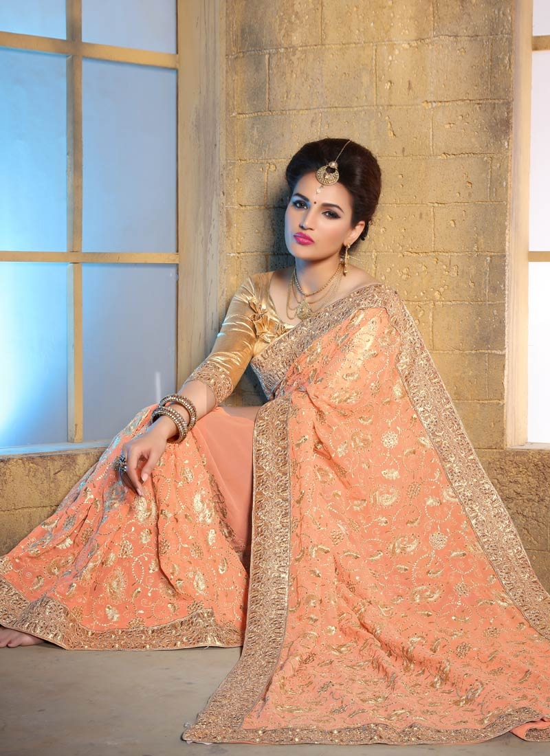 Sophisticated Stone Work Peach Color Wedding Saree