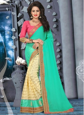Sorcerous  Beads Work Cream and Turquoise Bamberg Georgette Half N Half Saree