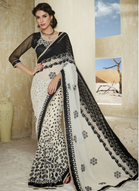 Spellbinding Black And Cream Color Lace Work Designer Saree