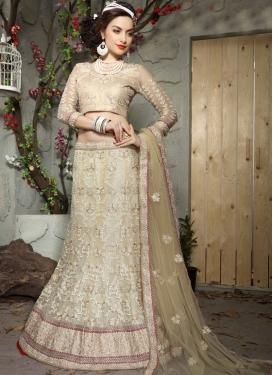 Spellbinding Patch Border Work Beige Color Designer Lehenga Choli