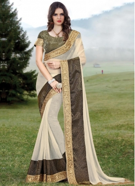 Staggering  Cream and Olive Lycra Traditional Designer Saree