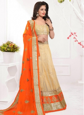 Suave Cream and Orange Booti Work A Line Lehenga Choli For Festival
