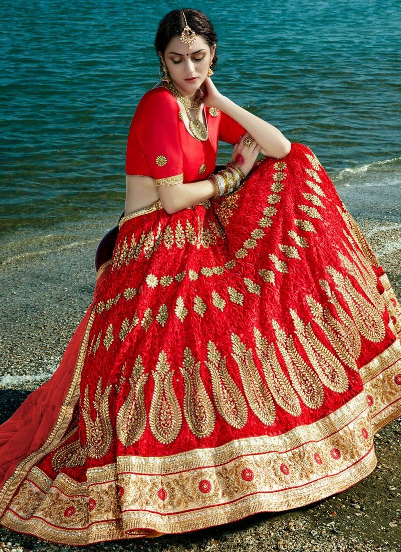 Sumptuous Booti Work Net Red Color Bridal Lehenga Choli
