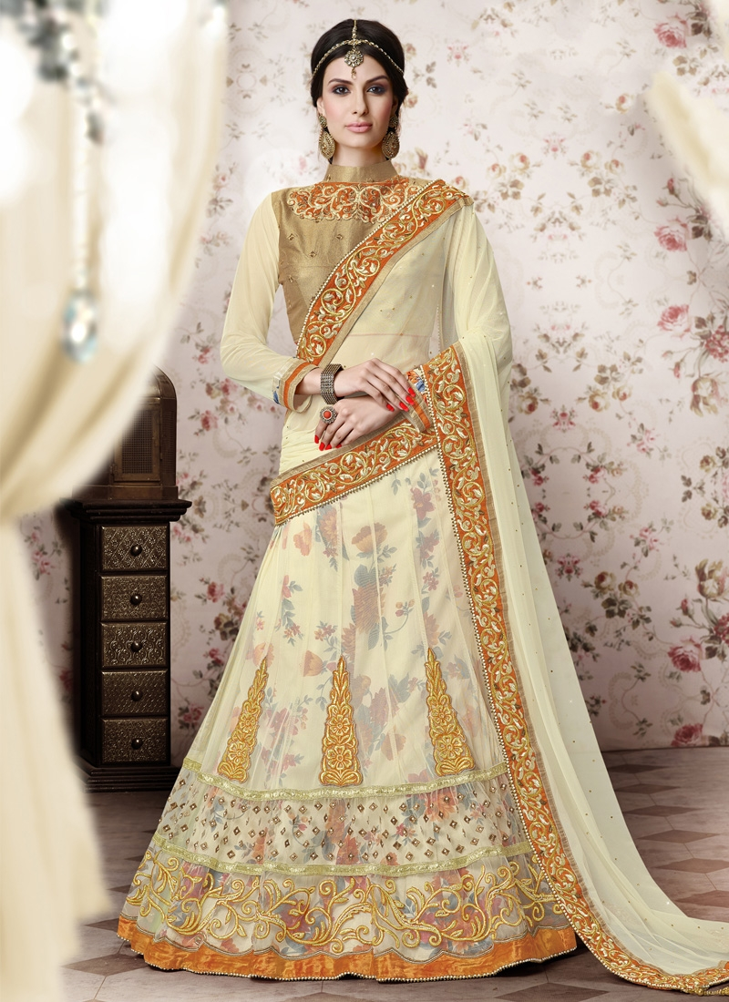 Superb Cream Color Booti Work Net Wedding Lehenga Choli
