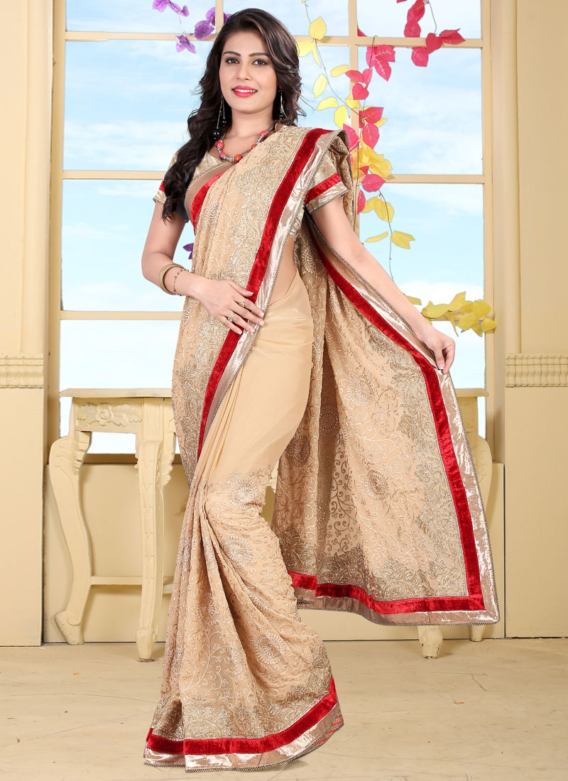 Swanky Lace And Stone Work Wedding Saree