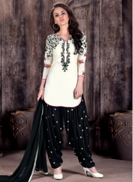 Tempting Black and Off White Embroidered Work Patiala Suit