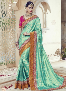 Tempting Jacquard Silk Aqua Blue and Rose Pink Contemporary Style Saree