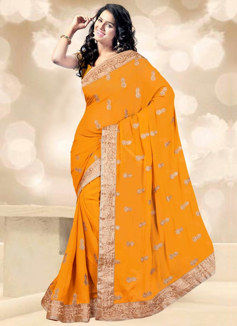 Tempting Mustard Color Stone Work Party Wear Saree