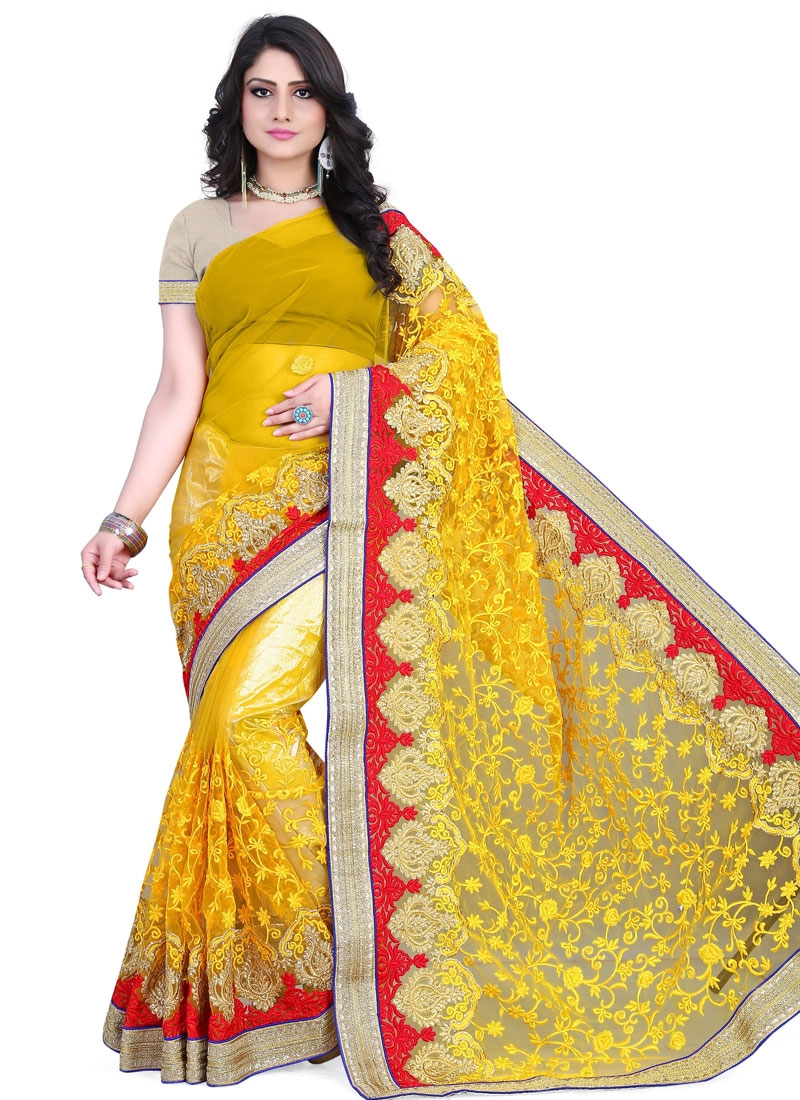 Tempting Yellow Color Lace work Wedding Saree