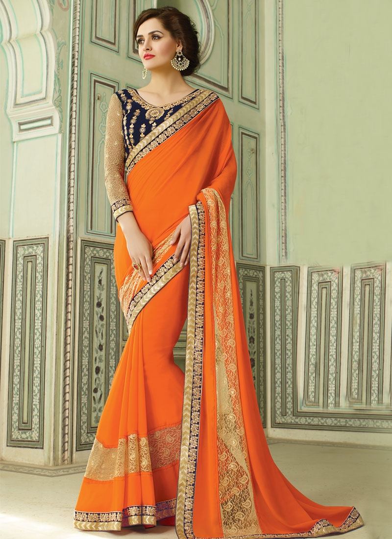 Thrilling Orange Color Lace Work Party Wear Saree