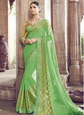 Tiptop Mint Green Color Faux Georgette Party Wear Saree