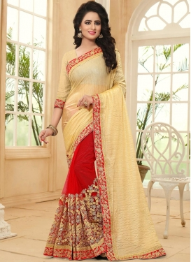 Titillating Crush Cream and Red Half N Half Saree For Festival